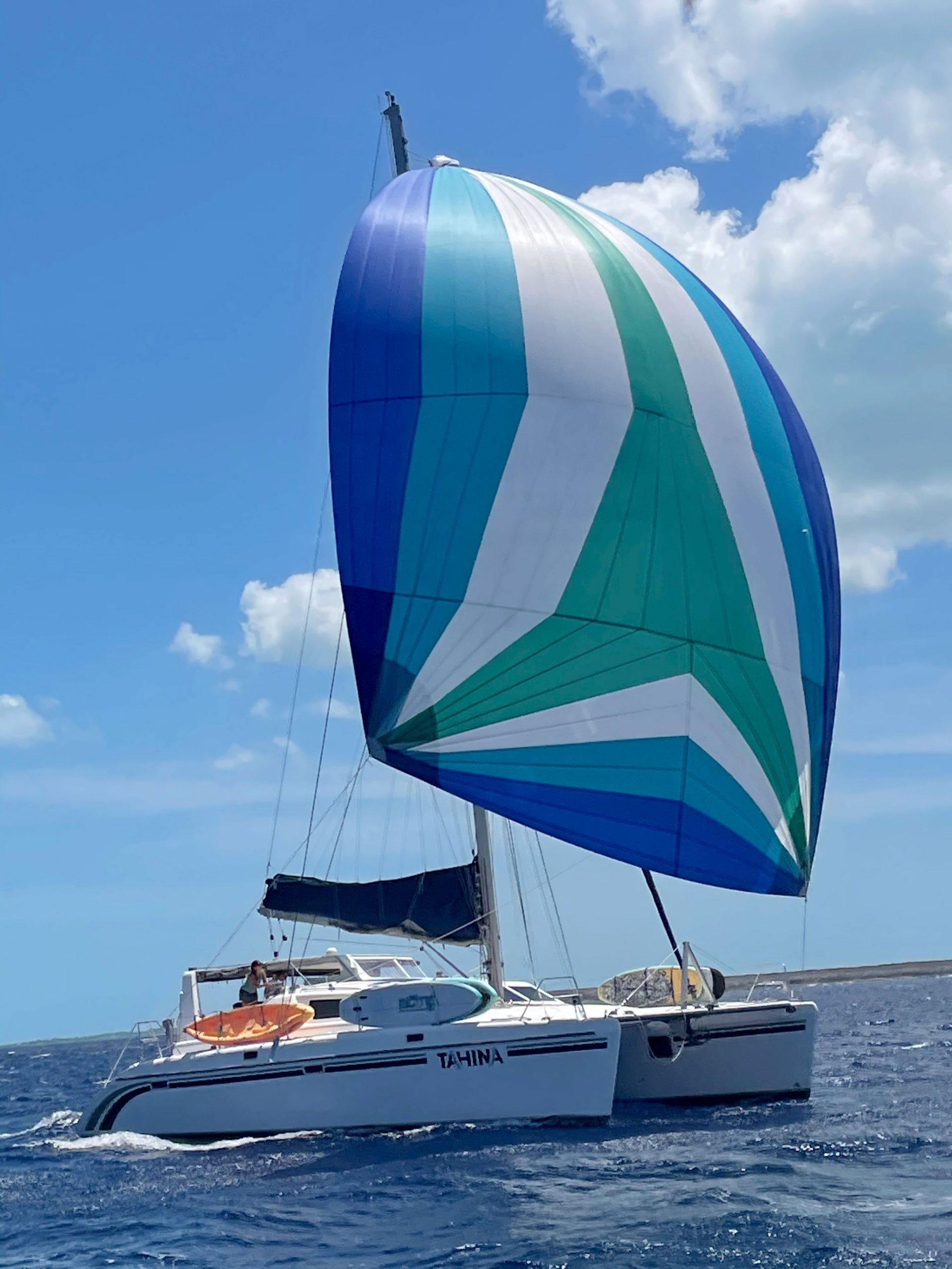 Catamaran sailing with spinnaker hoisted